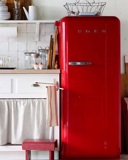white rustic kitchen with red smeg vintage fridge